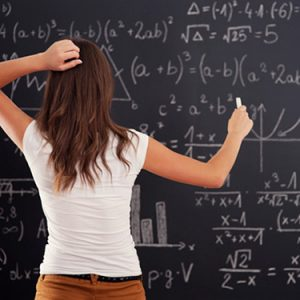 young-woman-looking-at-math-problem-on-blackboard_web